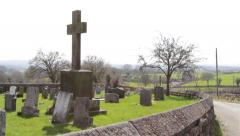 Pan From Old Countryside Rural Church Yard to Winding Road - Blue Sky Stock Footage
