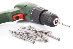 Drill and set of drill bits on white Stock Photos