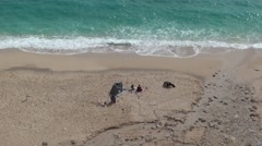 Native beach and a family Stock Footage