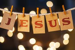 Jesus Concept Clipped Cards and Lights - stock photo