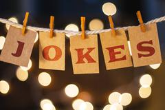 Jokes Concept Clipped Cards and Lights - stock photo