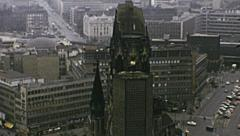 West Berlin 1974: Kaiser-Wilhelm-Gedächtniskirche and panorama of the city - stock footage