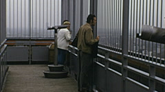 West Berlin 1974: people watching the city from the terrace of Europa center Stock Footage