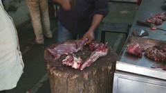 Indian man chopping meat at the butchery in Mumbai. - stock footage