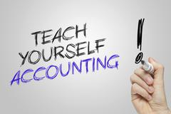 Hand writing teach yourself accounting - stock photo
