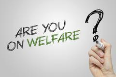 Hand writing are you on welfare - stock photo