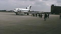 West Berlin 1974: people embarking at Tempelhof airport - stock footage