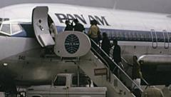 West Berlin 1974: people embarking in a Pan Am aircraft at Tempelhof airport Stock Footage