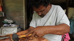Local Wood Carver works in his wood shop on- PALAU Stock Footage