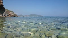 Clear water with stones and sea Stock Footage