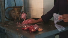 Indian man mincing and sorting meat at the butchery in Mumbai. - stock footage