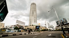 Motion Timelapse of Traffic in front of Komtar in Penang, Malaysia Stock Footage