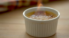 Flame on the creme brulee Stock Footage