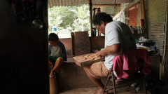 Stock Video Footage of Local Wood Carver works in his wood shop - PALAU
