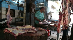 Indian man sharpening knife at a butchery in Mumbai. - stock footage