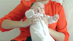 Close Up Parent holding baby. Happy Mother and Baby Stock Footage