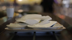 Camera centered on conveyor belt following a tray of dirty dishes Stock Footage