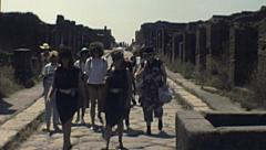 Pompei  1980s: guided tour on roman ruins Stock Footage