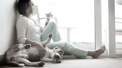 Happy family, mother and son on floor with friendly beagle dog Stock Footage
