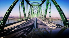 Contrasty footage: car's crossing the river by the bridge Stock Footage