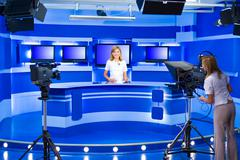 television anchorwoman and teleoperator work at TV studio - stock photo
