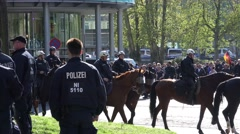 4k Pegida demonstrators walk away security Braunschweig Stock Footage