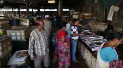 View on people working and buying at the market in Mumbai. Stock Footage