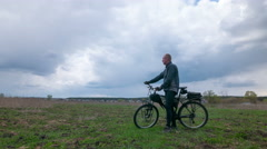 Adult man  cyclist against clouds. 4K (4096x2304)   Time lapse without bird Stock Footage