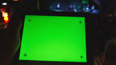 Using Tablet PC  with a green screen  in  night club . Stock Footage