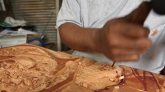 Local Wood Carver works in his wood shop - PALAU - stock footage