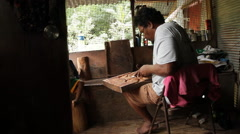 Stock Video Footage of Worker in his Shack with Wood in PALAU