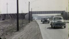 CARS APPROACHING ON HIGHWAY 1960s Vintage Old Film Home Movie 8078r Stock Footage