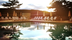 Evening sun shineson  open air pool in a luxurious resort Stock Footage