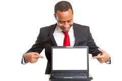 African business man presenting your product in a laptopcomputer Stock Photos