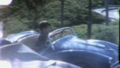 Boy Drives Car Kiddy Ride Amusement Park 1950s Vintage Film Home Movie 8080r - stock footage