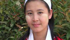 Portrait of Burmese girl with tanaka make up on face, Yangon, Myanmar Stock Footage