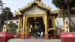 Tourists take off shoes and enter pagoda, Myanmar - stock footage
