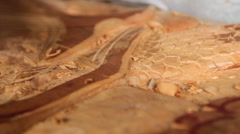 Local Wood Carver carves Manatee Sculpture Stock Footage