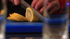 Chef cuts the lemon Stock Footage