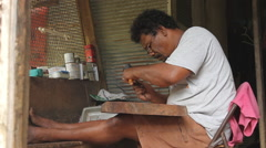 Stock Video Footage of Local Wood Carver - PALAU