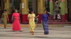 Burmese women visit Bago Shwemawdaw Pagoda, Myanmar Stock Footage