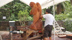 Local Wood Carver- PALAU - stock footage