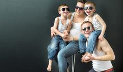 Happy family on black studio background Stock Photos