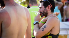 Triathlon runner or athlete after reaching goal coughing and recovering Stock Footage