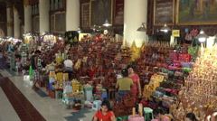 Religious souvenirs for sale at Shwethalyaung Pagoda, Bago, Myanmar Stock Footage