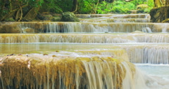 River with many cascades and waterfalls in tropical jungle rain forest. Loop vid Stock Footage
