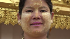 Portrait of Burmese girl with tanaka make up on face at pagoda, Myanmar Stock Footage