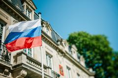 Stock Photo of Russian Federation flag waving in front of Consulate of Russia