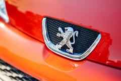 Peugeot logo on a red car Stock Photos