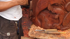 Local Wood Carver carves Manatee Scuplture Stock Footage